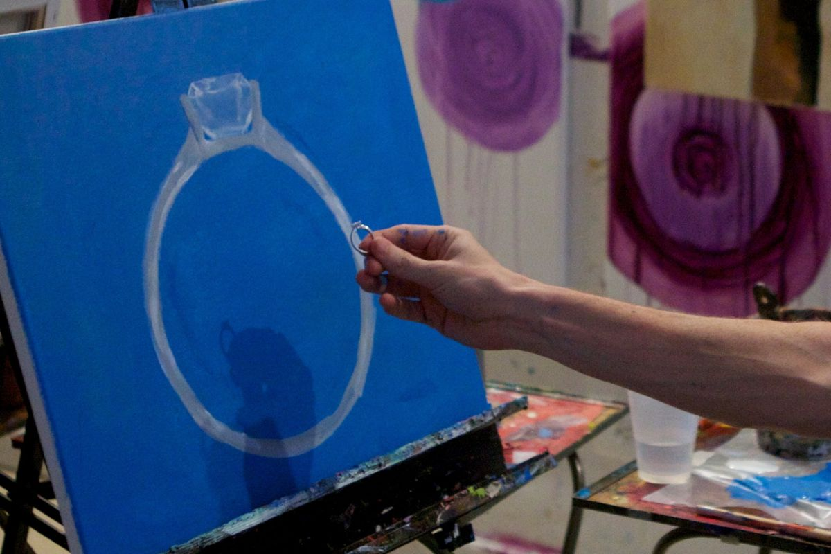 The ring and painting on the easel.